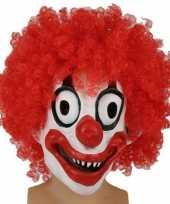 Angstaanjagend clownsmasker met rode krullen